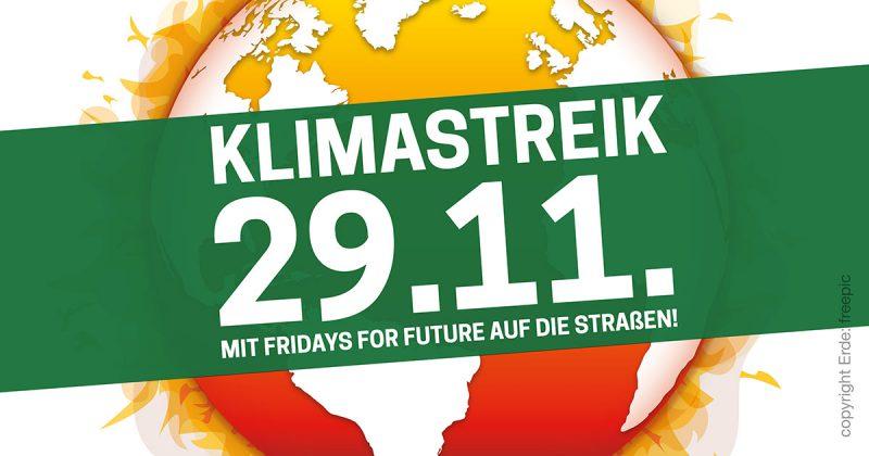 Klimastreikbanner für den 29. November 2019. Großes Feld mit dem Datum quer über einem brennenden Globus.